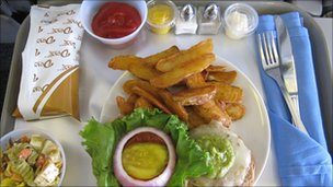 A lunch consisting of a burger served on the plane