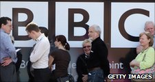 People in front of a BBC sign