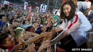 Yingluck Shinawatra shakes hands with supporters after a rally on 1 July 2011 in Bangkok