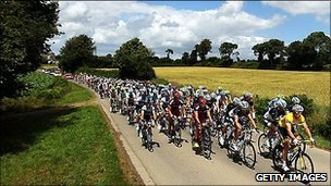 Riders in the 2011 Tour De France race their way through the French countryside
