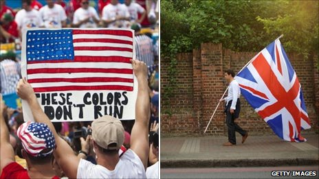 "[American holding a ""These Colors Don't Run"" sign, Brit carrying a Union Jack]"