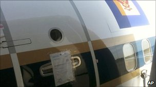 The seal of a bailiff on the door of a grounded Boeing 737 of the Royal Thai Air Force at the airport in Munich