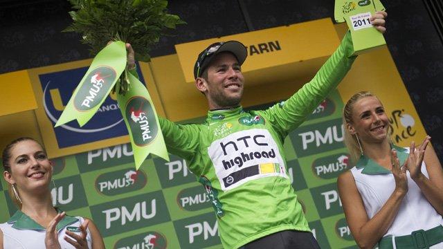 Britain's Mark Cavendish, celebrates on the podium after his 18th Tour de France victory