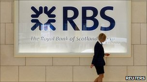 A worker in foyer of a Royal Bank of Scotland office in London