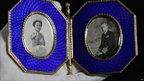 A Faberge double photograph frame containing portraits of King George VI and Queen Elizabeth