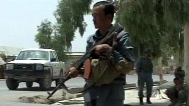 Security forces on guard by scene of the attack