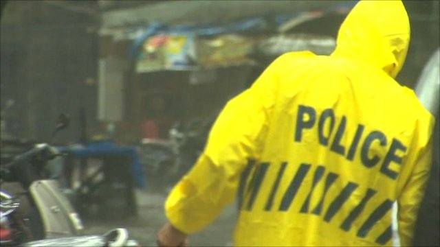 Indian police officer in Mumbai monsoon rains