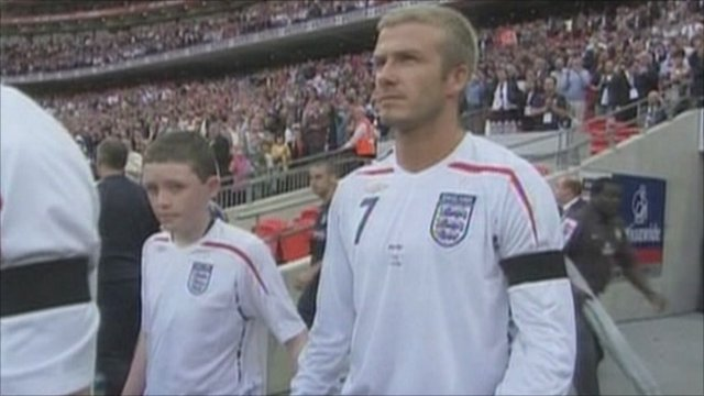 Robert Sebbage steps out as the England football mascot alongside David Beckham in 2007