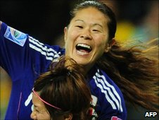 Sawa celebrates a goal against Sweden
