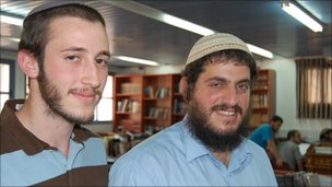 Rabbi Yehuda Amar (R) and student, Eliyahu Gross (L) in the Ra'anana yeshiva library.