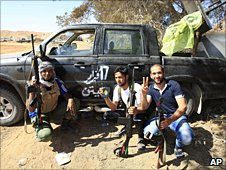 Young fighters pose for a picture on the front line near Misrata