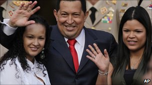 Venezuela&#039;s President Hugo Chavez, waves flanked by his daughters Rosa Virginia (R) and Gabriela, after he announced he would return to Cuba Saturday to begin a new phase of cancer treatment that would include chemotherapy 