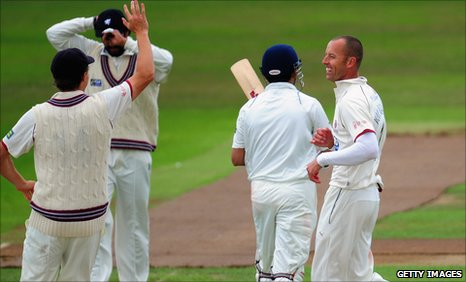 Charl Willoughby (right) celebrates the wicket of Gautam Gambhir