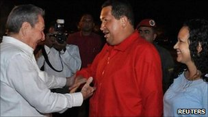 Cuba' President Raul Castro ((left) greets Venezuela's President Hugo Chavez and his daughter Rosa Virginia  at Havana airport