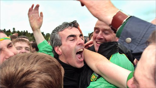 Donegal manager Jim McGuinness is mobbed by happy fans after the final whistle