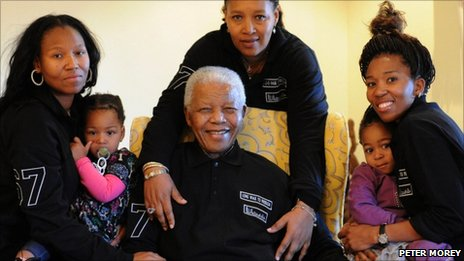 A picture released by the Mandela family ahead of Nelson Mandela's 93rd birthday shows Mr Mandela (C), flanked by (from L) Zaziwe Manaway and baby Ziphokazi Manaway, daughter Princess Zenani Dlamini and Zamaswazi Dlamini with baby Zamakhosi Obiri
