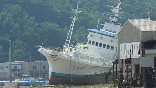 Boat: Volunteers in Ishinomaki are frustrated with the pace of the recovery effort