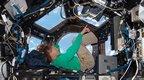 Astronaut Sandy Magnus at work
