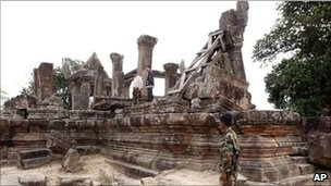 A Cambodian soldier stands near Cambodia's famed Preah Vihear temple.