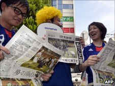 Fans read about Japan's World Cup final win