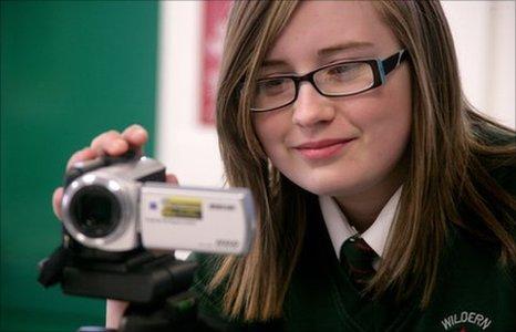 A School Reporter from Wildern School using a video camera