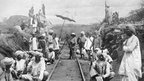 Indian workers constructing the line