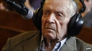 Sandor Kepiro, a Hungarian man now acquitted of Nazi-era war crimes, sits in a wheelchair at Budapest Municipal Court on 29 June 2011 before the start of the ninth day of his trial
