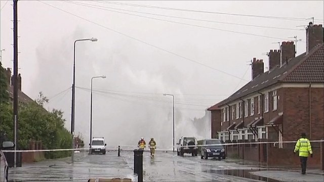 Water sprays out of a burst water main in Huyton