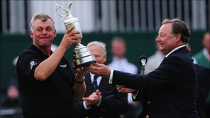 Darren Clarke is presented with the Claret Jug