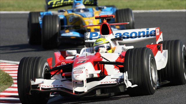 Toyota's Ralf Schumacher is pursued by Fernando Alonso