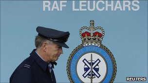 Forces person walks past RAF Leuchars sign