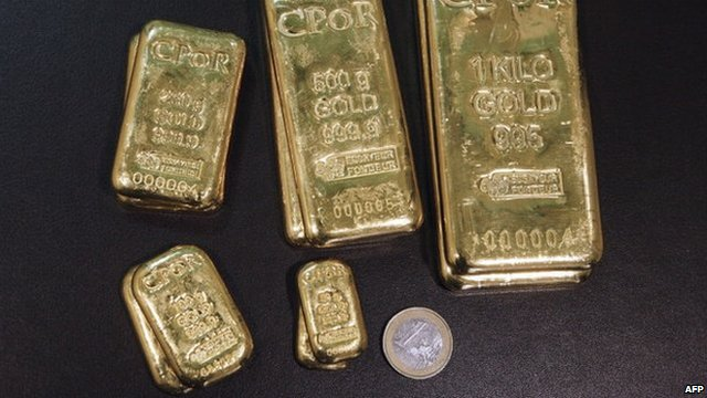 Gold bars and euro coin