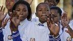 Children in Qunu, South Africa, sing a birthday song
