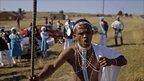 Onke Gawazela sings outside Mr Mandela's home