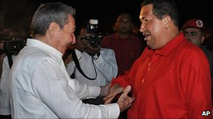 Cuba' President Raul Castro ((left) greets Venezuela's President Hugo Chavez at Havana airport