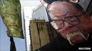 A defaced image of Li Ka-shing