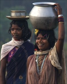 Two women carrying water, Dongria