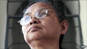 Kamariah Ali waits outside a courtroom before her trial at Federal Courthouse in Kuala Lumpur, 29 November 2005.