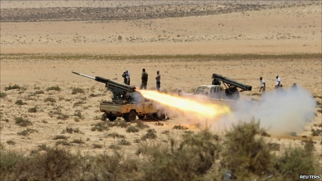 Rebel forces fire artillery guns