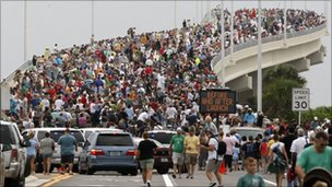 Spectators line the A.Max Brewer bridge in anticipation of the launch of the space shuttle Atlantis in Titusville