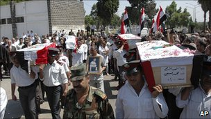 Image from Syrian official news agency Sana said to show police funerals in Homs