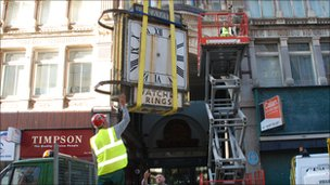 H Samuel clock being taken away for work
