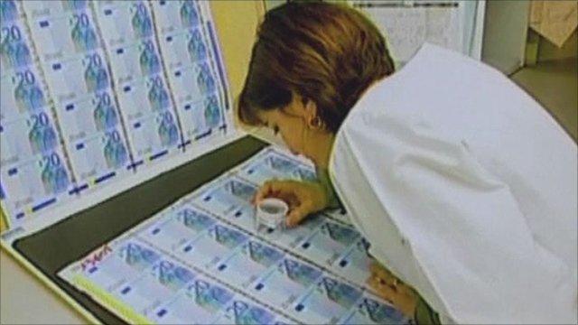 woman examining euro notes