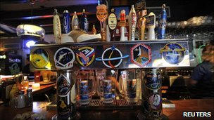 Stickers from various Nasa missions adorn the beer tap at Dogs R Us, a restaurant and bar in Titusville, Florida July 6, 2011