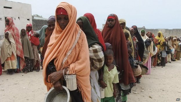 Hungry women and children queue up for food at a camp in Somalia's capital Mogadishu