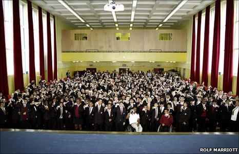Pupils in school hall pose for group photo
