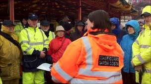Search teams in fluorescent coats