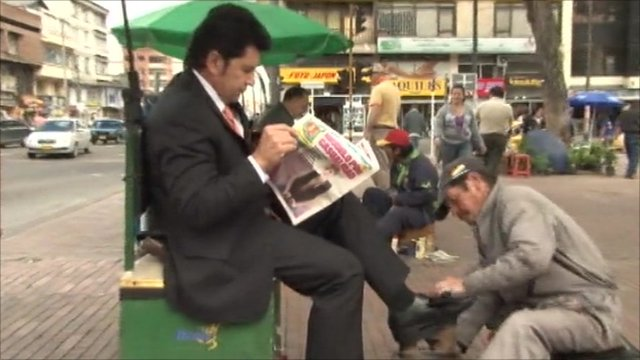 Newspaper reader in Bogota, Colombia