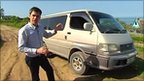 Daniel Sandford in front of an imported Japanese van in Sakhalin