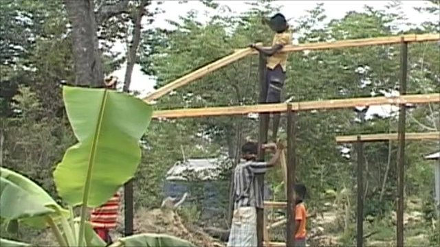 Men build house in Sri Lanka